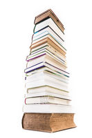 Pile of old and new books isolated on white background