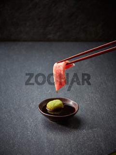 Raw tuna slice or tuna sashimi