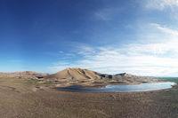 Large lake near sandy desert