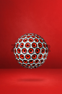 Speakers sphere on a red studio background