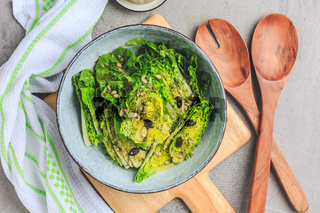 Lettuce salad with olive oil dressing in bowl