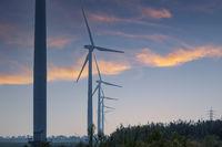 coastal wind farm at dusk