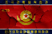 flag of Korean People's Army Ground Force painted on cracked wall