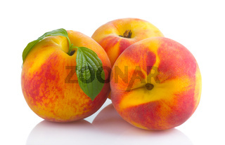 Ripe peach fruits with green leave isolated