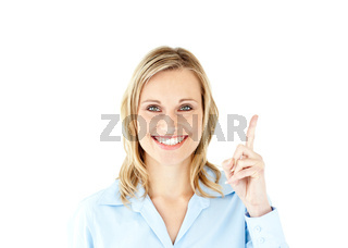 Smiling businesswoman pointing upwards with her finger