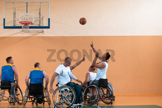 a photo of basketball teams with disabilities with the selector in the big hall before the start of the basketball game
