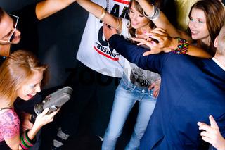 Karaoke girl performing in night club