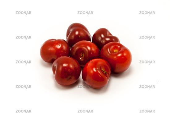 A handful of juicy ruby red cherries