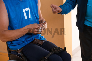 a handicapped basketball player prepares for a match while sitting in a wheelchair.preparations for a professional basketball match. the concept of disability sport