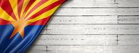 Arizona flag on white wood wall banner, USA