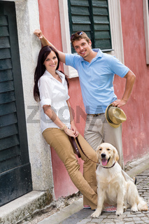 Modern couple with dog in the city