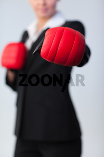 woman showing boxing glove to the camera