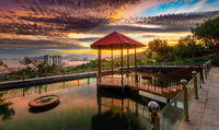 Pavilion on the pond at sunset. Panorama