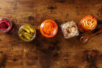 Fermented foods. A variety of pickled vegetables, shot from above