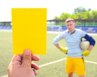 Copy space for inscription Football referee Hand holding and showing yellow card
