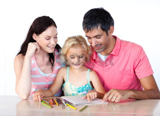 Father and mother drawing with her daughter