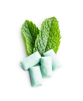 Mint chewing gum pads and green mint leaves