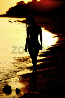 ocean woman in sunrise light