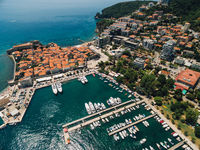The old town of Budva and the pier for boats and yachts on the waterfront.