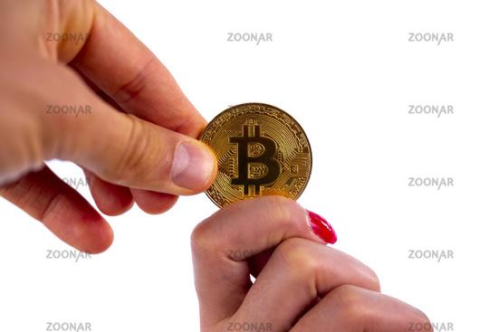 Bitcoin coin in hands
