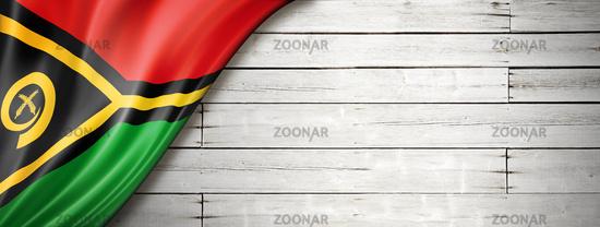Vanuatu flag on old white wall banner