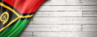 Vanuatu flag on old white wall banner