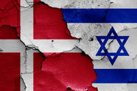 flags of Denmark and Israel painted on cracked wall
