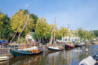 Cityscape medieval city Naarden with canal and historic sailing ships
