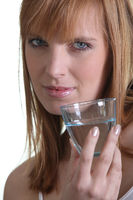 Woman showing a glass of water