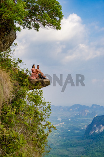 couple mid age men and woman trekking in the Thai jungle near Krabi hiking to the top of Khao Ngon Nak Nature Trail Krabi Thailand or Dragon Crest,couple, Thailand