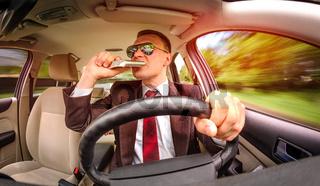 Drunk man driving a car vehicle.