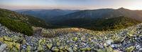 Summer evening Carpathian mountain stony slope panoramic view in last sunset sunlight. Vysoka Mountain, Gorgany Carpathian massive, Ukraine.
