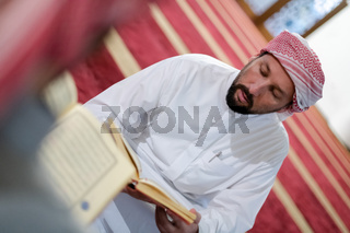 two muslim people in mosque reading quran together concept of islamic education