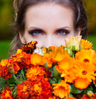 A beautiful brunette with flowers