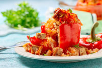 Pepper stuffed with tofu, rice and vegetables.