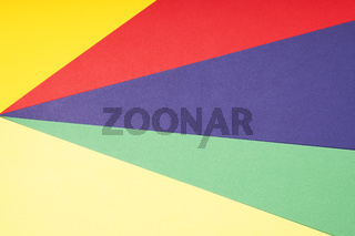 multicolor paper background in red pruple green and yellow