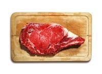 Beef prime rib on a cutting board