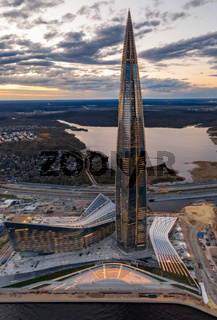 Russia, St.Petersburg, 06 May 2020: Aerial panoramic image of skyscraper Lakhta center at sunset, night illumination is on, It is the highest skyscraper in Europe, Completion of construction