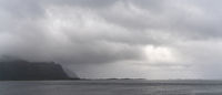 Panorama of a mystical fjord and Atlantic ocean on a cloudy and foggy summer day in the Lofoten Islands of northern Norway