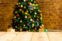 Composition of christmas tree with decorations and copy space on blurred background