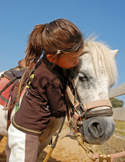 child and pony