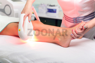 Laser epilation and cosmetology in beauty salon. Cosmetology, spa and hair removal concept