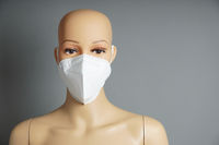shop window mannequin or display dummy head wearing FFP2 face mask