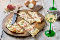 Typical tarte flambée with onions and bacon
