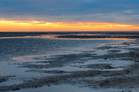 Sunset in the Lower Saxony Wadden Sea off Cuxhaven Sahlenburg at low tide, Germany