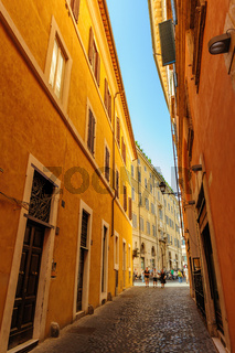 Narrow streets with old mediaval residential buildings in Rome, Italy