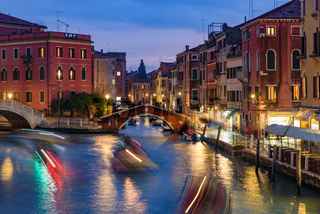 Night view of the canal, bridge, and old buildings in Venice, Italy