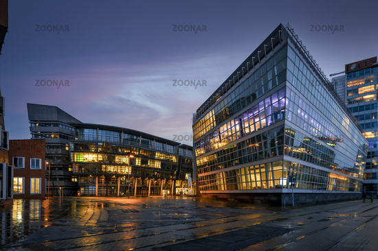 Office buildings at the commercial port at dusk.