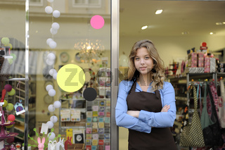 small business owner in front of gift store