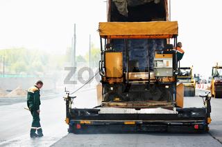 worker at asphalting works